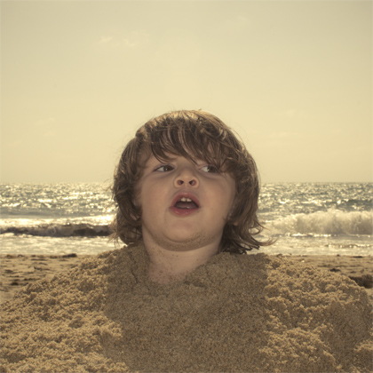 The boy in the sand.